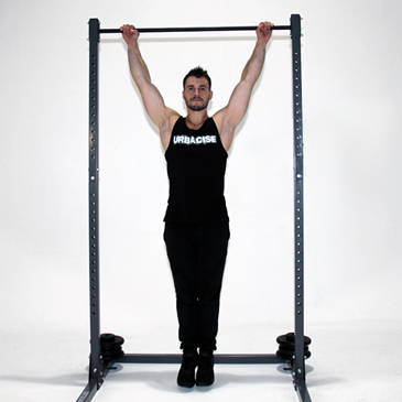 Fitness model performing a archer pull-up
