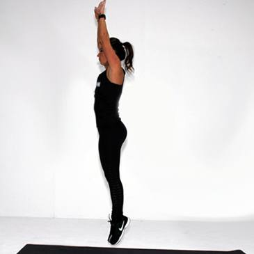 Fitness model performing a burpee