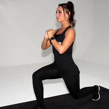 Fitness model performing a body weight lunge