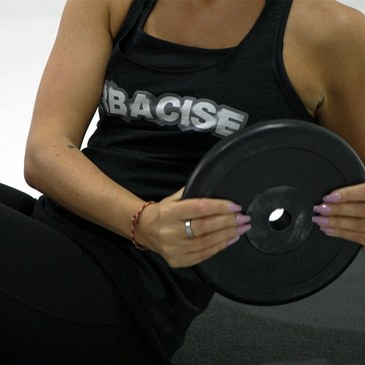 Close up of a fitness model performing a Russian twist