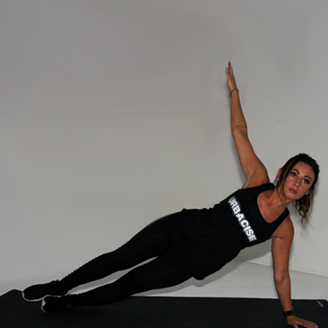 Fitness model performing a side plank