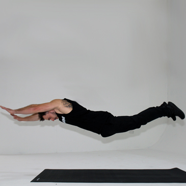 Fitness model performing a superman push-up