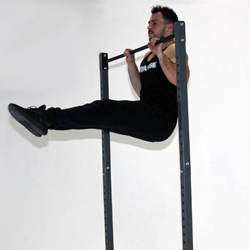 Fitness model performing a L-sit pull-up