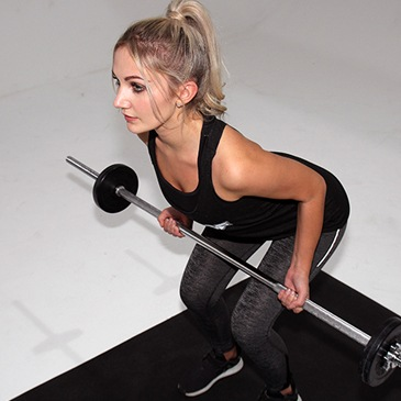 Fitness model performing a bent over row