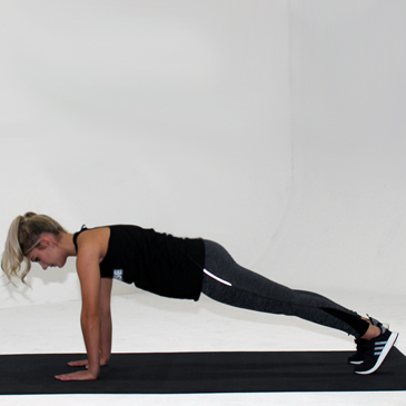 Fitness model performing the inchworm exercise
