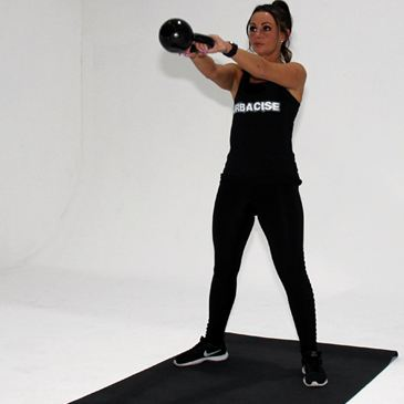 Fitness model performing a kettle bell swing