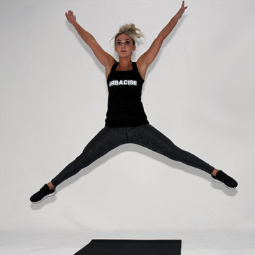 Fitness model performing a star jump