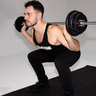 Fitness model performing a barbell squat
